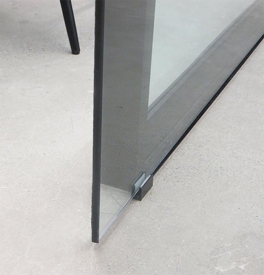 Glass sliding door floor guide