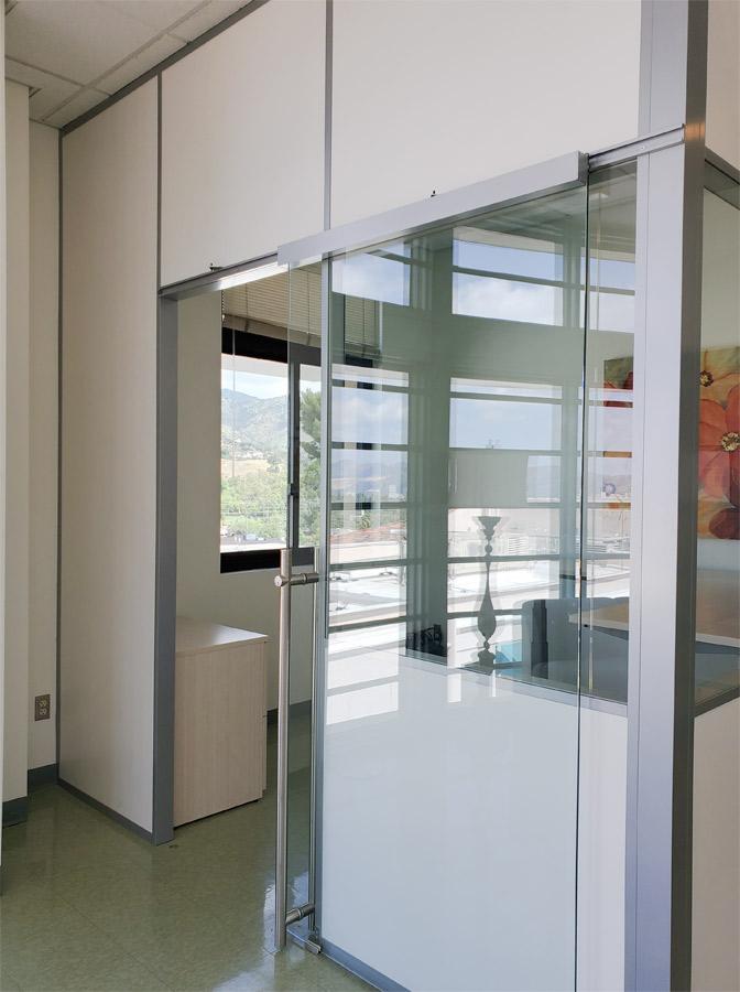 Demountable wall office with locking sliding glass door