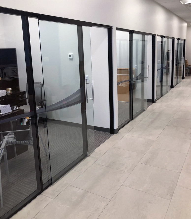 Flex series glass offices and black colormatch extrusions installation