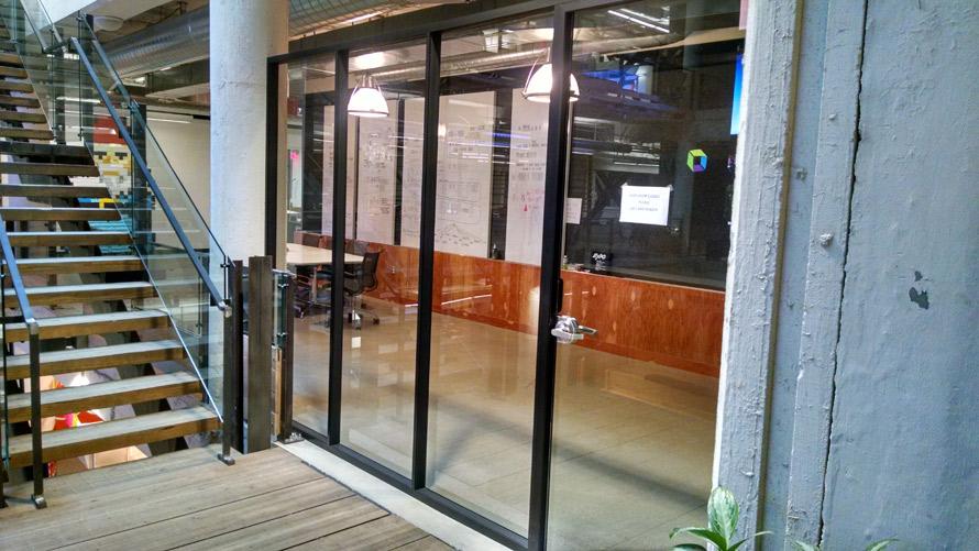 Freestanding glass conference room black framing Ford Field (Detroi, MI)