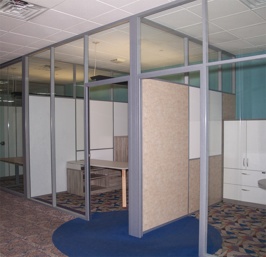 Glass offices with whiteboards solid panel demising walls