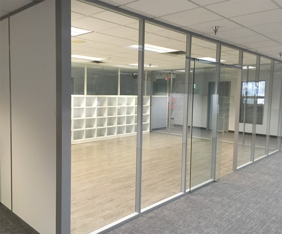 Glass walls with solid full-height wall panels and sliding glass door