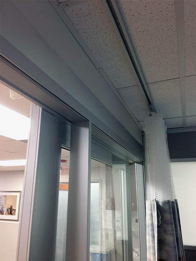 Patient room demountable walls with c-rail privacy curtains