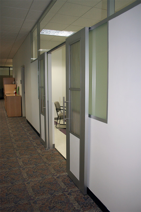 Double aluminum frame sliding doors with Flex series walls and opaque glass inserts