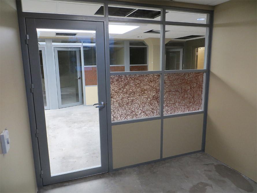 Offices with aluminum framed glass insert swing doors