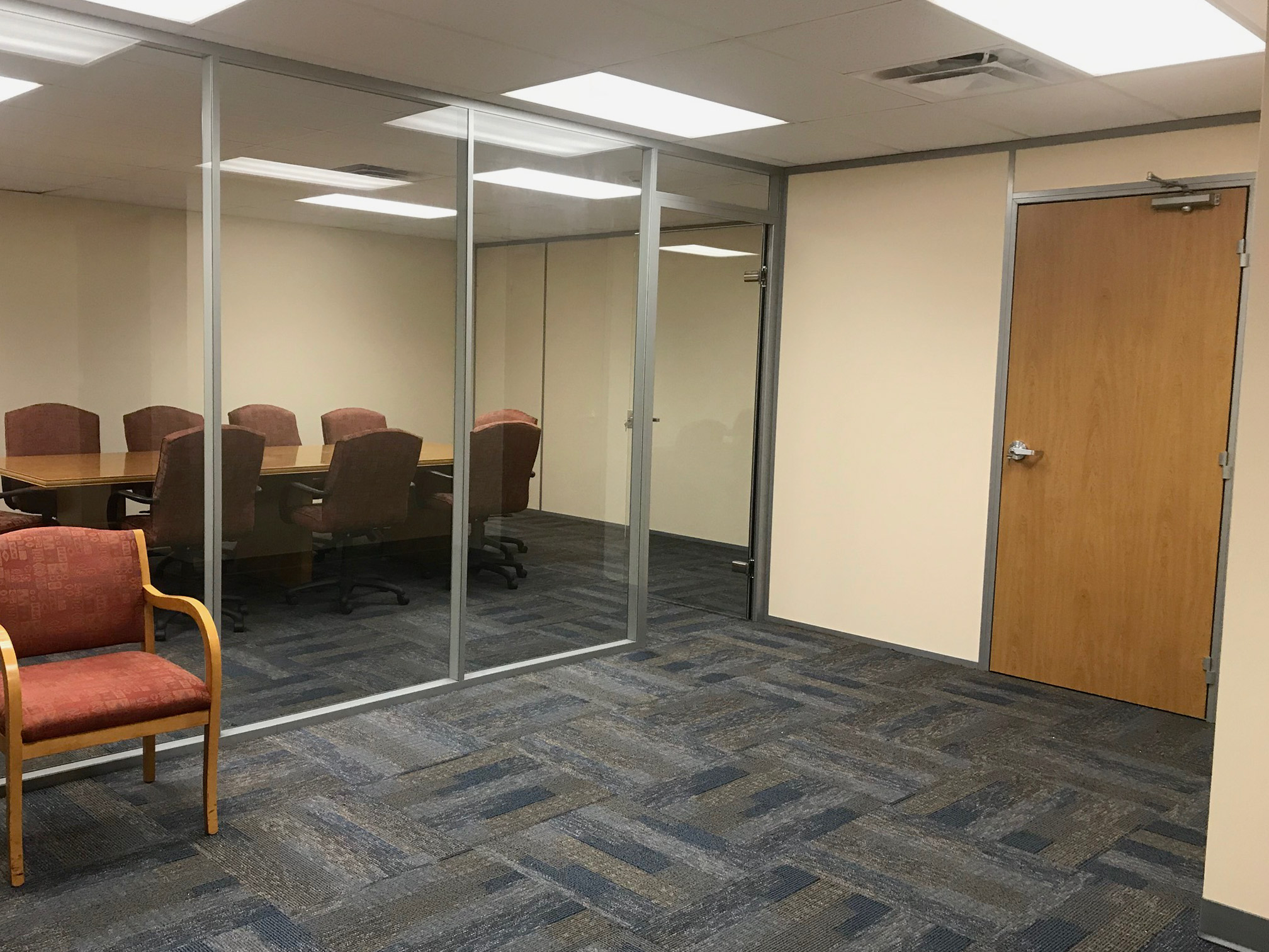 Glass conference room with swing doors - financial institution installation