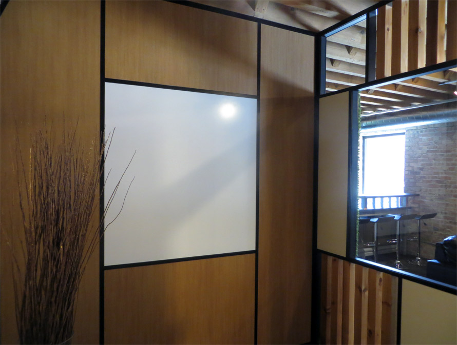 Integrated whiteboard wall with black extrusions and glazing bead