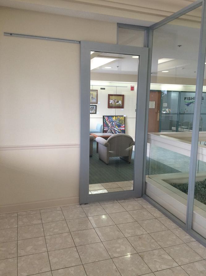 Sliding C-rail aluminum frame glass door closed