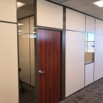 Demountable wall office with wood door - Brownstone frame color paired with clay stud bead