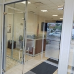 All glass double swing doors - Credit Union Installation