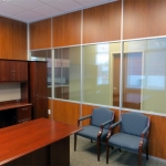 Solid laminate wood and glass panel Communication Center office