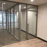 Glass walls with locking sliding glass door financial sector installation