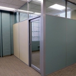 Solid panel office with clerestory & aluminum framed glass door