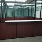 Reception top installation - wood base wall with glass top wall panels - Flex Series