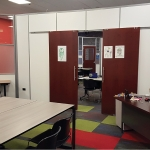 Wood double sliding doors - education installation