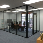 Black aluminum and glass conference room