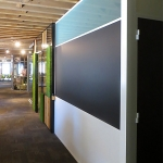 Frosted glass clerestory integrated chalkboard wall with white aluminum extrusions