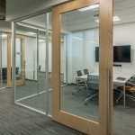 NxtWall Flex Series offices with wood frame sliding doors
