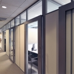 Enclosed offices with sliding aluminum framed glass doors