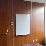 Solid wood panel walls with mounted whiteboard