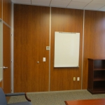 Wood wall office with solid wood swing door