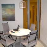 Office accent curved corner wall with colored film glass