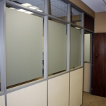 Frosted glass and clerestory wall with veneer wood door