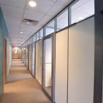 Solid wall panel offices with glass clerestory demountable wall partitions