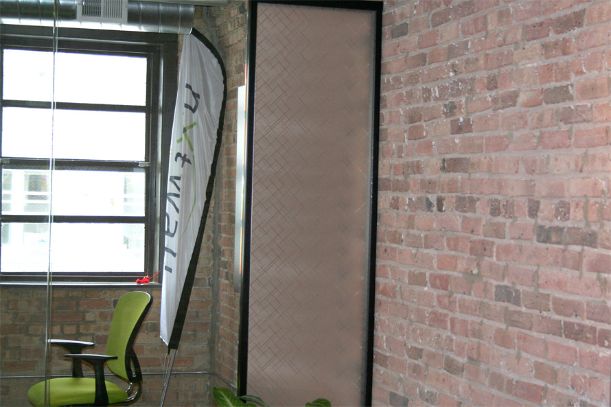 Decorative custom applied film on glass panel