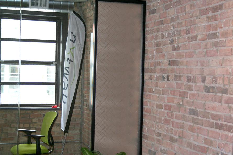 Decorative custom applied film on glass panel