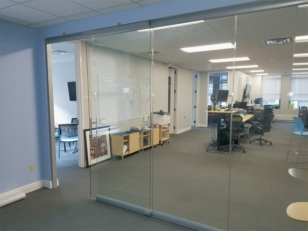 Sliding frameless glass door with soft close hardware