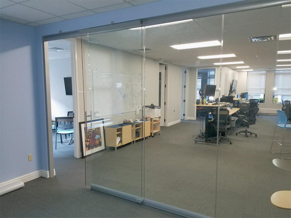 Sliding frameless glass door with soft close hardware