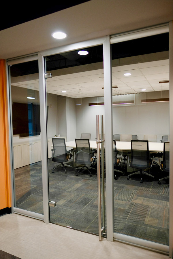 glass door with locking door pull meeting room