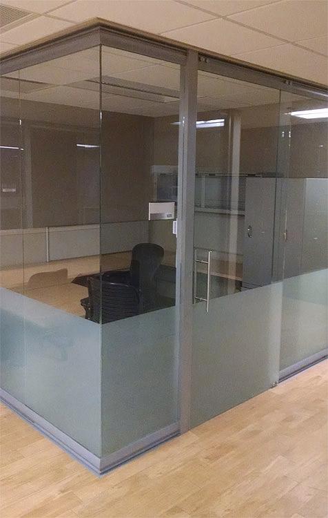 Glass office with frameless glass sliding door