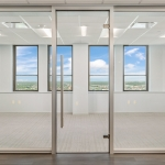 Anodized aluminum door frame with frameless glass swing door