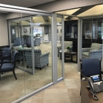 Architectural glass offices freestanding wall installation at Bank