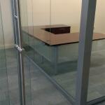 Bank glass wall installation with locking barpull sliding doors