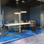 Conference room glass wall installation with sliding double doors