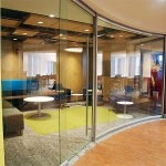Curved glass lounge room - View Series glass walls