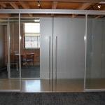 Double frameless glass sliding doors - conference room