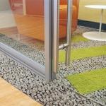 Frameless glass swing door with barpull hardware - detail