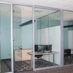 Full height frameless glass swing door Flex Series office with View Series open corner