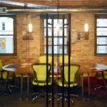 Glass conference room sliding door black pull hardware detail