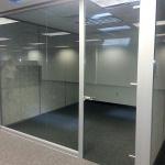 Glass office with frameless glass door