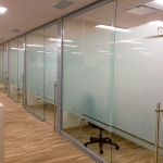 Glass offices with locking sliding frameless glass doors