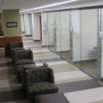 Floor to ceiling glass walls with sliding frameless glass doors