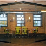 NxtWall field-fit View series conference room with double sliding glass doors