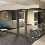 Glass Wall Reception Area with Brownstone Finish - University Installation