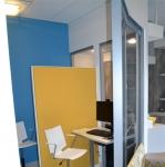 Angled glass divider wall