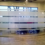 Full height glass conference room with curved wall and glass swing door - View series